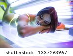 young woman laying on solarium... | Shutterstock . vector #1337263967