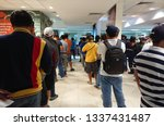 Small photo of Riyadh / Saudi Arabia - November 27, 2018 : People are waiting in line to remit money via a money transfer service