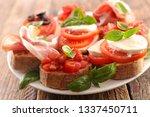 bruschettas with tomato  ham ... | Shutterstock . vector #1337450711