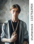 Small photo of Junkie with noose around neck, gonna kill himself