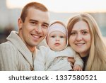 young happy family smiling at... | Shutterstock . vector #1337580521