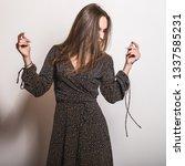 beautiful girl in stylish dress ... | Shutterstock . vector #1337585231