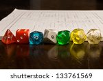Role Play Dice on wooden table top with a map in the background - stock photo