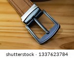 fashion leather belt  on wooden ... | Shutterstock . vector #1337623784