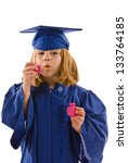 Young graduate blowing bubbles - stock photo