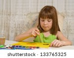 Young girl painting - stock photo