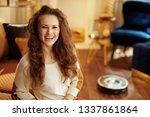 smiling modern housewife with... | Shutterstock . vector #1337861864
