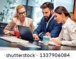 three business colleagues... | Shutterstock . vector #1337906084