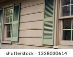 faded shutters on the outside... | Shutterstock . vector #1338030614