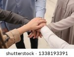group of people holding their... | Shutterstock . vector #1338193391