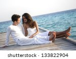 happy loving couple in white... | Shutterstock . vector #133822904