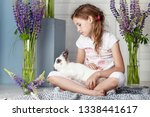 little girl playing with real...   Shutterstock . vector #1338441617