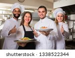 smiling chefs and young nippy... | Shutterstock . vector #1338522344