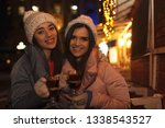 friends with glass cups of... | Shutterstock . vector #1338543527