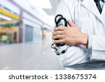 male doctor with stethoscope on ... | Shutterstock . vector #1338675374