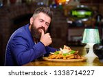 Small photo of Businessman formal suit sit at restaurant. Man received meal with fried potato fish sticks meat. He deserve delicious meal. Enjoy your meal. High calorie snack. Delicious food. Relax after hard day.