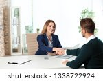 human resources manager shaking ... | Shutterstock . vector #1338722924