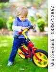 active blond kid boy in...   Shutterstock . vector #1338752867