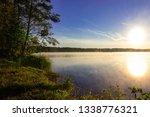 foggy summer lake sunrise  | Shutterstock . vector #1338776321