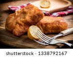 two fried cod fillet pieces.... | Shutterstock . vector #1338792167
