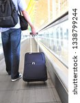traveler with a suitcase on the ... | Shutterstock . vector #1338799244