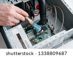 hand of professional repairman... | Shutterstock . vector #1338809687