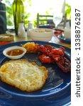 resort breakfast of fried egg... | Shutterstock . vector #1338876287