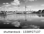 puddle water reflection of sky... | Shutterstock . vector #1338927137