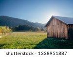 wooden barn in meadow in...   Shutterstock . vector #1338951887