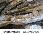a heap of poured and crushed... | Shutterstock . vector #1338989921