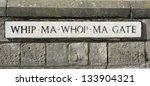 Small photo of Historic Whip Ma Whop Ma Gate street sign in York, England.