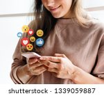 cheerful woman watching a video ... | Shutterstock . vector #1339059887