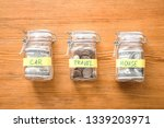 jars with money for different... | Shutterstock . vector #1339203971