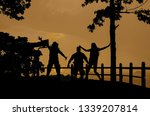silhouette happy group of... | Shutterstock . vector #1339207814