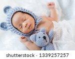 newborn baby in bear hat... | Shutterstock . vector #1339257257