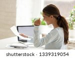 profile of happy woman holding... | Shutterstock . vector #1339319054