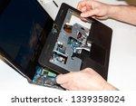 male hands disassemble laptop...   Shutterstock . vector #1339358024
