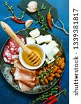 antipasti on white plate and on ... | Shutterstock . vector #1339381817