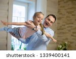 overjoyed father and daughter... | Shutterstock . vector #1339400141