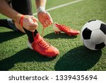 picture of man lacing soccer... | Shutterstock . vector #1339435694