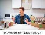 recycling. young smiling man is ... | Shutterstock . vector #1339435724