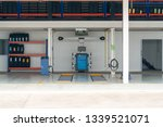 Small photo of Workshop bay of wheel alignment with tyre in a car repair station. empty tire shop with Wheel and new tire.