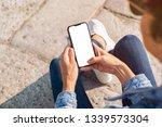 closeup of young woman hand... | Shutterstock . vector #1339573304
