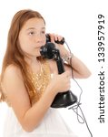 Young red headed child talking on a vintage telephone - stock photo