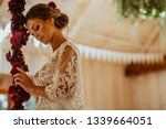 beautiful young bride in white... | Shutterstock . vector #1339664051