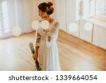beautiful young bride in white... | Shutterstock . vector #1339664054