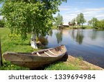 boat on the lake near the birch ... | Shutterstock . vector #1339694984