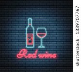 glass of wine and bottle of red ...   Shutterstock .eps vector #1339707767