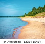 Sandy Beach coastline of Lake Michigan from Whitefish Dunes State Park in Door County Wisconsin.