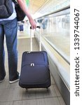 traveler with a suitcase on the ...   Shutterstock . vector #1339744067